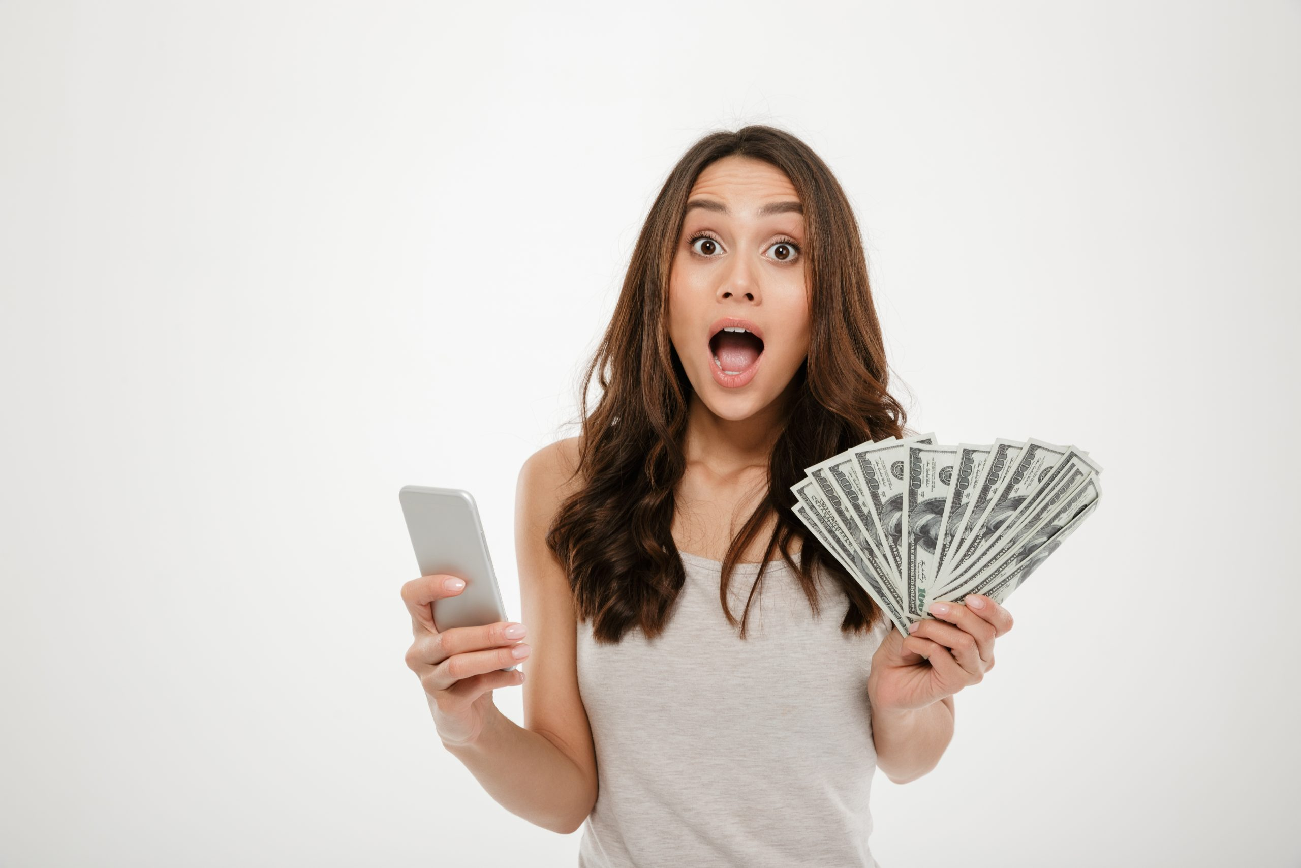 Portrait of attractive brunette female 30s winning lots of money
